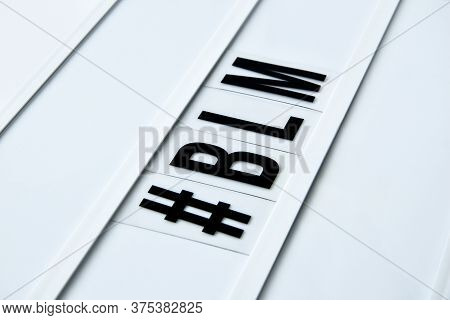 Hashtag Blm Black Lives Matter Text On A White Background. Protest Against The End Of Racism, Anti-r