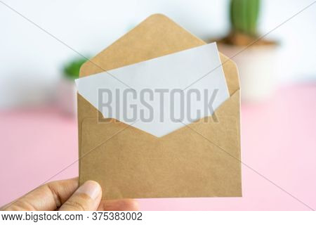 Card With Envelope,has Space For Text. Brown Envelope With A Blank Piece Of White Paper.