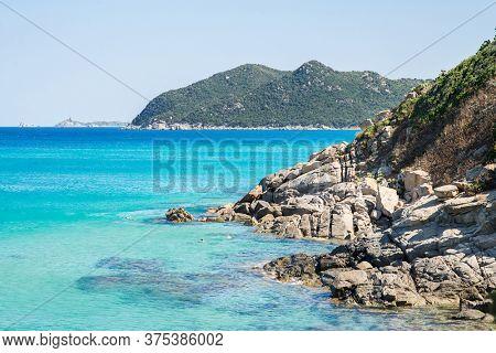 Mediterranean Sea and Coast of Italian Island Sardinia. Blue Clear Sky.