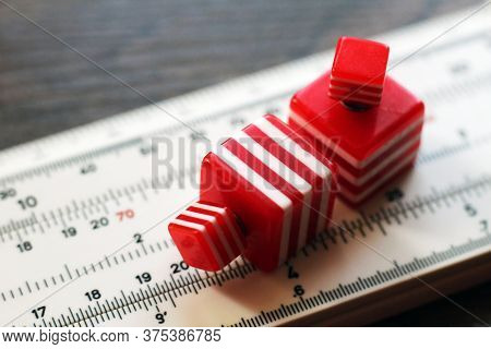 Red Earrings On Measuring Tool, Hand Made. So Close.