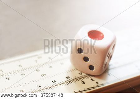 One Dice And Measuring Instrument So Close