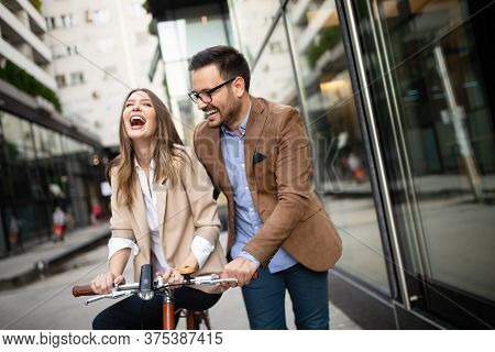 Office Woman With Business Man Couple Enjoying Break While Talking Flirting Outdoor