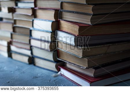 Stack Of Books Background. A Lot Of Books. A Stack Of Books Of Different Thicknesses In The Library,