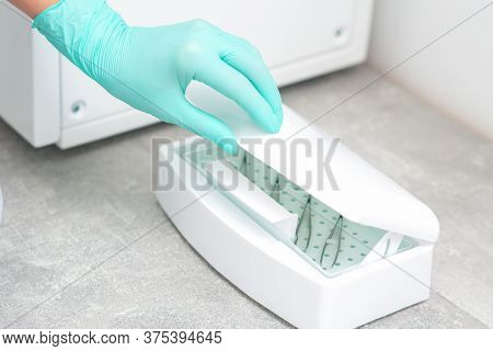 Hands Cleans Tools Of Medical Instruments With Cleaning Systems. Ultrasonic Cleaner.