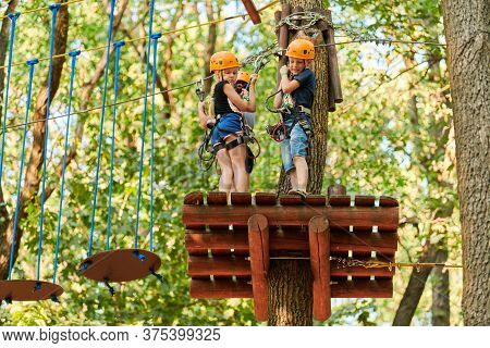 Voronezh, Russia - 24.08.2019 - Kids In High Ropes Experience Adventure Tree Park. Children On Rope