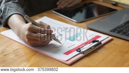 Business Woman Analyse And Discuss On Business Graph Document