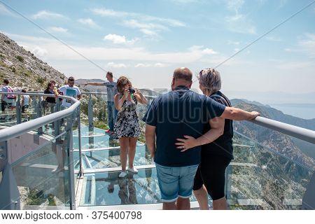 Biokovo, Croatia July 2020 An Older Tourist Couple Getting Their Photo Taken On The Newly Constructe