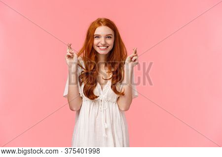 Confident, Optimistic And Hopeful Cute Redhead Female In White Dress, Cross Fingers Good Luck And Sm
