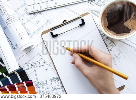 Architect Workplace Top View. Architectural Project, Blueprints, Blueprint Rolls On Table. Construct