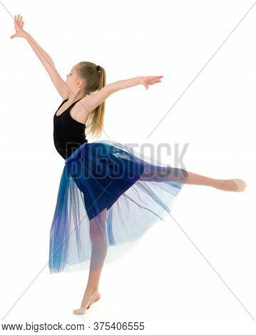 Pretty Girl Gymnast Standing On Tiptoe And Looking To The Side, Portrait Of Beautiful Graceful Teena