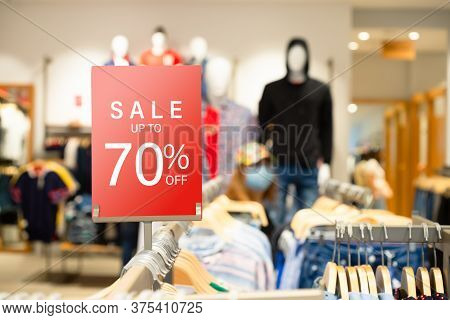 Sale Label Stand Template On Shelve In Male Clothing Store For Sale Promotion And Discount Informati