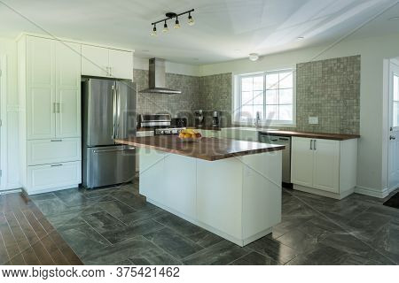 New Grey And White Kitchen With Marble Tiles, Appliances And Timber Bench Tops