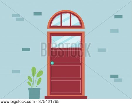 Red Front Entry Door With Arched Transom Window On Blue Wall With House Plant