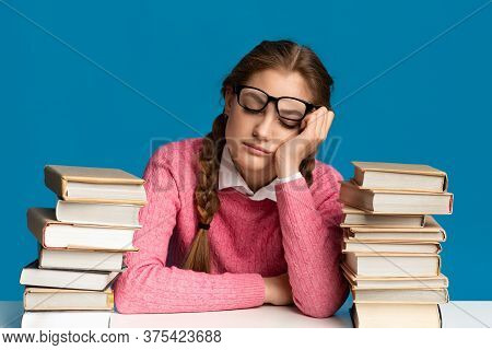 Girl Teenager In Glasses Fell Asleep Surrounded By Books