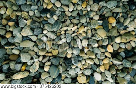 Small Stone Texture Background. Pebble Stone On The Beach. River Stone For Garden Decoration. Smooth