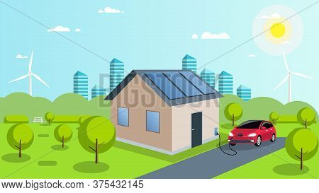An Electric Car Is Charged By Solar Energy. Solar Panels On The Roof Of The House. Car In The Parkin