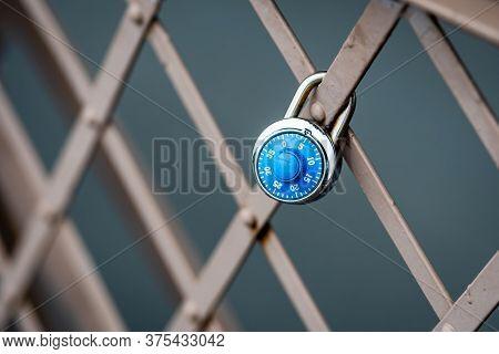 A Symbolic Padlock At The Brooklyn Bridge Railing, Nyc, Usa
