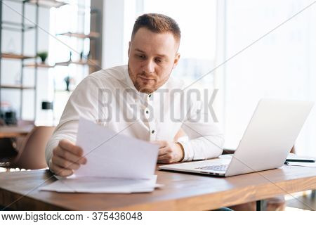 Business Man Wearing Fashion Casual Clothing Is Typing On Laptop Computer And Working With Paper Doc