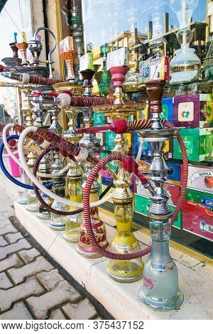Luxor, Egypt - Jan 30, 2020: The hookah at the street gift shop in Egyptian souvenir shop at Hurgada. Egypt.