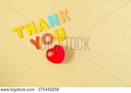 Thank You Words And Red Heart Isolated On Background. Red Heart And Text Thank You Of Colorful Wood