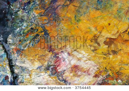 Close-up of the dry oil paint on the painterґs palette - pastose colour coating poster