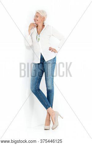 Pretty Blonde Confident Mature Woman Posing In Studio.