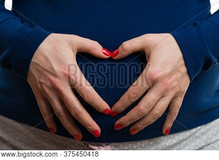 Closeup Of Pregnant Woman Making Heart Gesture On Abdomen As Love Concept Isolated On White Backgrou
