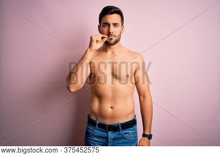 Young handsome strong man with beard shirtless standing over isolated pink background mouth and lips shut as zip with fingers. Secret and silent, taboo talking