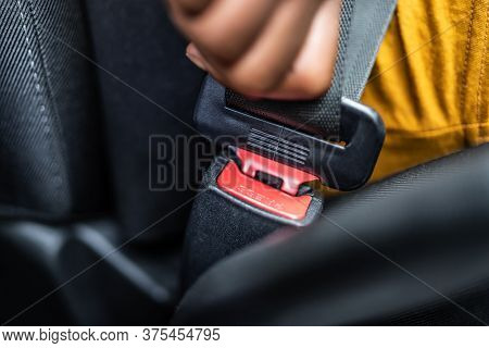African Woman Buckling Up Seatbelt To Drive Car Safely