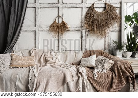 Cozy Living Room Interior In Boho Chic Style With Couch, Comfortable Cushions, Bedspread, House Deco