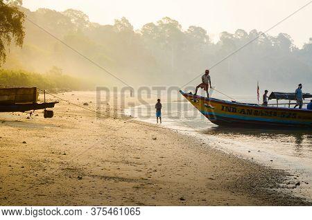 Andaman Island, India - 23 Mar 2015: Fishermen Drag Their Boat Back To Shore, At Dawn, After A Fishi