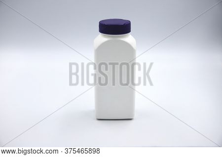 White Plastic Bottle For Pills Or Food Supplement Studio Photo On White Background. Pharmacologic Pa