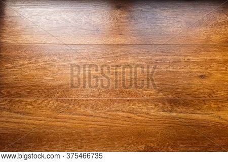 The Background Is Made Of Wooden Table Boards. The Wooden Table Is Textured.