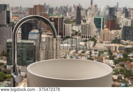 Modern Hygienic Hand Basin With Cityscape That Can Look Outside From Big Window. Elegant Faucets And