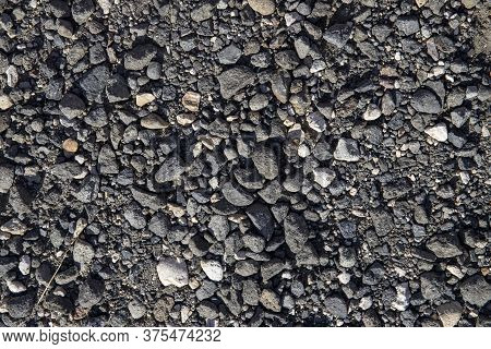 Grey Gravel Texture. Rustic Road Surface Top View. Big Gravel Closeup Photo For Background. Rough Gr