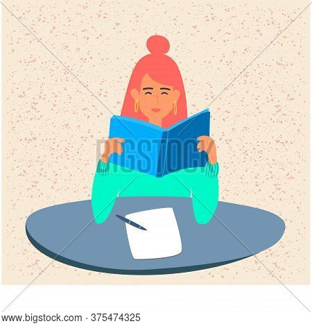 A Student Is Reading A Book, Preparing For Exams Or A School Test At The University.a Young Girl Is
