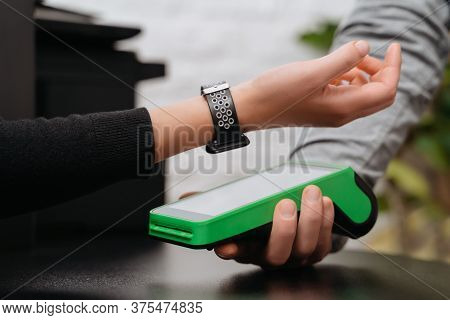 Client Making Contactless Payment By Smart Watch With Nfc Technology. Close-up Of Modern Woman With