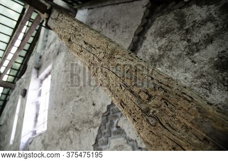 Wooden Rotten Beam In Truss On Soil