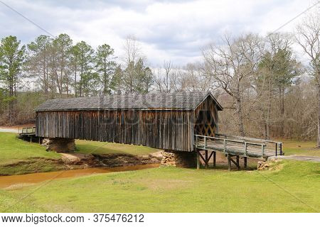 An Old Southern Style Vintage Rural Wooden Covered Bridge