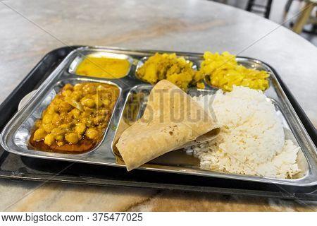 Indian Food Thali Curry Aloo Rice Peas Masala Lau Pa Sat, Singapore.