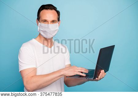 Portrait Of His He Nice Skilled Guy Wearing Safety Mask Working Remotely On Laptop Watch Video Lesso