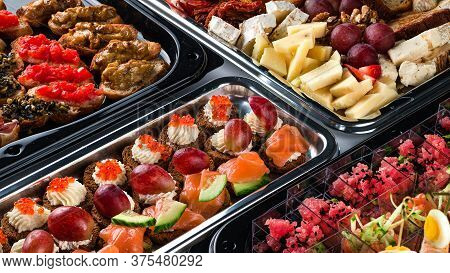 Beautifully Decorated Catering Banquet Table With Different Food Snacks And Appetizers With Caviar,