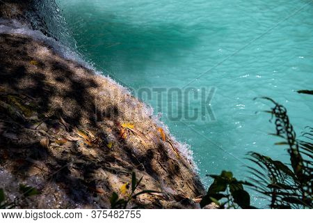 Blue Lake And Waterfall On Huge Rock. Wild Nature Environment Detail. Jungle Forest Hiking Concept.