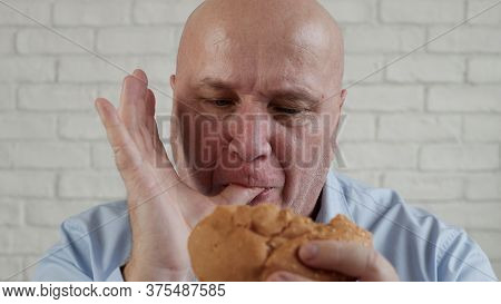 Starved Person Eating A Tasty Hamburger, Enjoy A Delicious Snack In A Fast Food