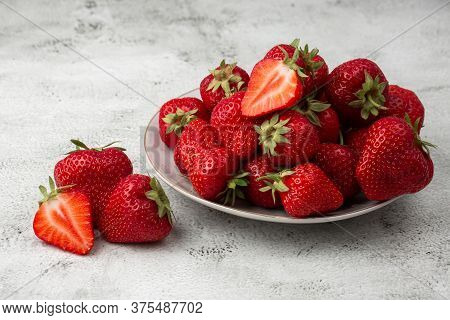 Fresh Strawberries In Plate On Marble White Table. Fresh Nice Strawberries. Strawberry Field On Frui