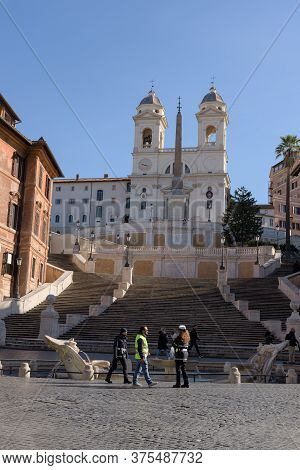Rome, Italy - 10 March 2020: People Wearing Face Masks Come Across The Spanish Steps Plaza While The