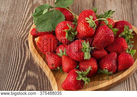 Fresh Strawberries In A Wooden Plate On Wooden Table. Fresh Nice Strawberries. Strawberry Field On F