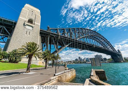 View Of Sydney Harbor Bridge And Sydney Downtown Skyline In Beautiful Day, Australia.