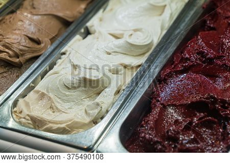 Vanilla And Chocolate Italian Gelato Ice Cream In The Gelato Shop, Italy
