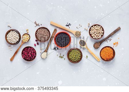 Legumes, Seeds And Cereals On A Gray Background. Healthy Food. Top View.